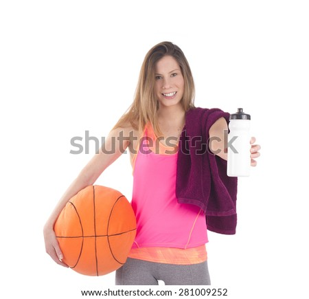 Young fit woman holding a basketball and a water bottle against a white background - stock photo