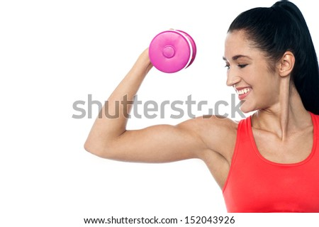 Young fit woman lifting dumbbell, isolated on white - stock photo