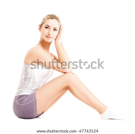 young fitness girl, posing over white, studio shot