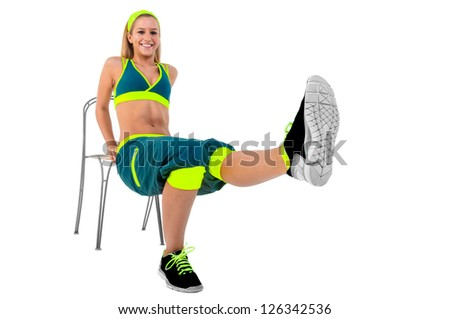 Young fitness instructor sitting on chair - stock photo