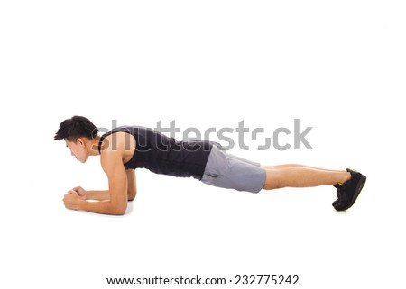 young fitness man doing plank core exercise working out  - stock photo