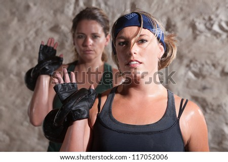 Young fitness partners resting weight over shoulder - stock photo