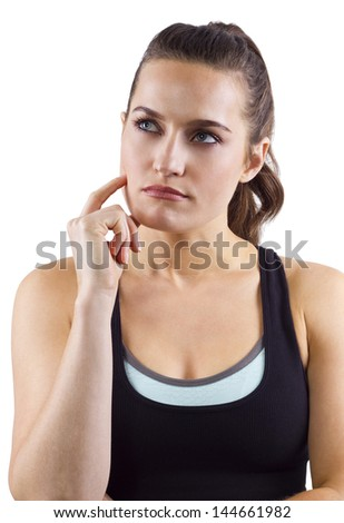 Young fitness trainer is thinking - stock photo