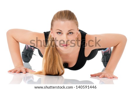 Young fitness woman doing push up, isolated on white background - stock photo