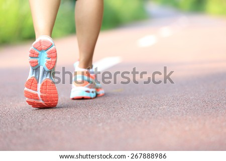 young fitness woman hiker legs at forest trail - stock photo