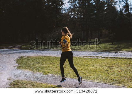 Young fitness woman jogging in the park