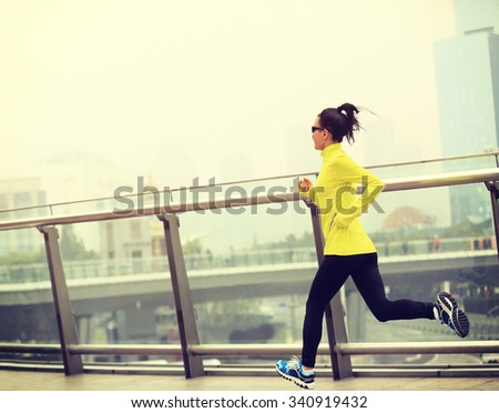 young fitness woman runner running on city - stock photo