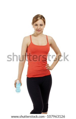 young fitness woman with a bottle of water on white background - stock photo