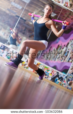 Young fitness woman with weight. - stock photo