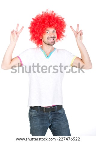 Young football fan with a wig on his head, isolated on white. - stock photo