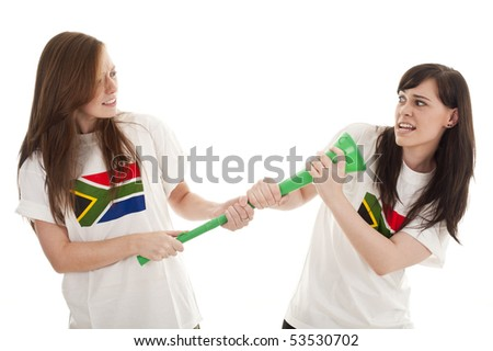Young football fans supporting their teams wearing South Africa shirts. - stock photo
