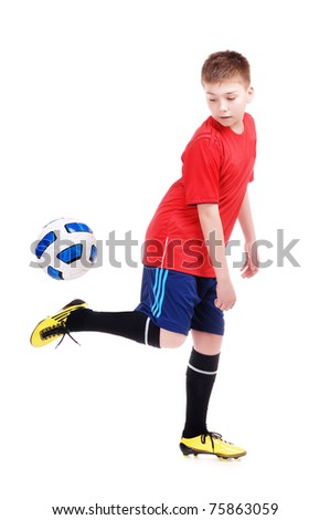 Young football player playing with a ball on white background - stock photo