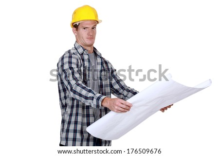 young foreman with blueprints isolated on white - stock photo