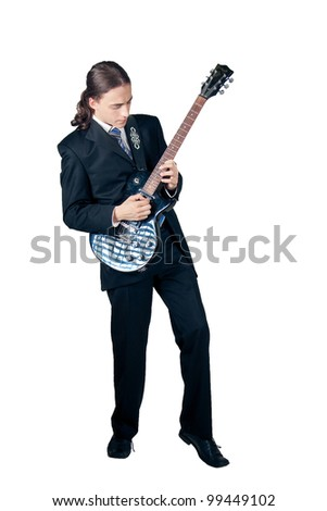 Young formal man rocking out with guitar isolated on white - stock photo