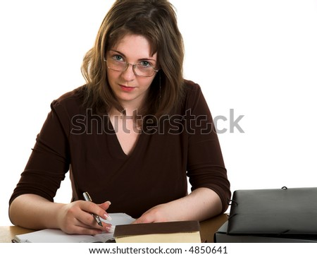 Young freckled woman sitting at the table with document