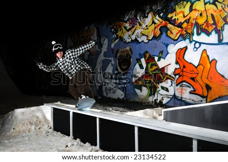 young free style snowboarder jumping in air and make acrobations - stock photo