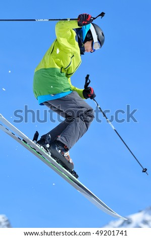 young freerider on skis  jumping - stock photo