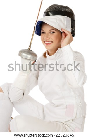 Young fresh beautiful laughing girl in fence costume with sword and fencing mask over white background - stock photo