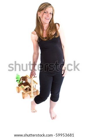 Young fresh pregnant woman is pulling  a trolley filled with toy animals isolated over white background. - stock photo