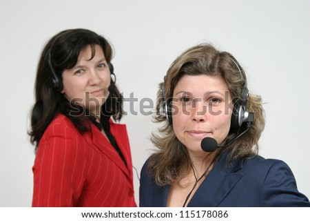 Young friendly brunette woman with headset smiling during conversation