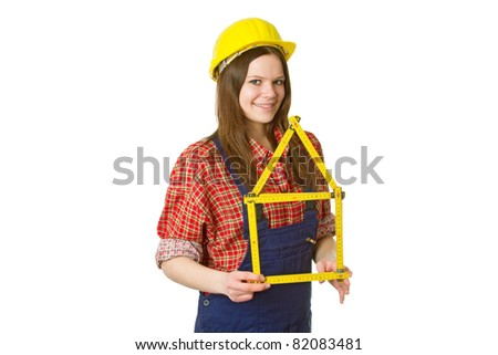 Young friendly craftswoman with folding rule isolated on white background - stock photo
