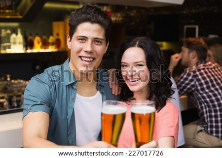 Young friends having a drink together at the bar - stock photo
