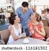 Young friends having coffee break - stock photo