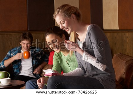 Young friends in cafe - stock photo