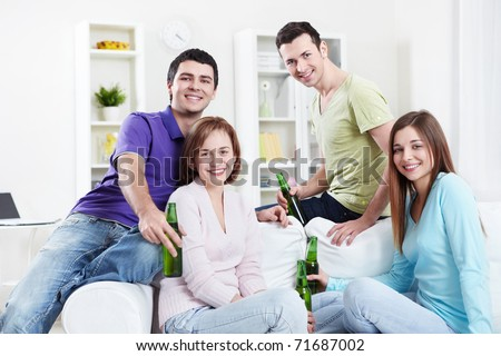 Young Friends of beer at home - stock photo