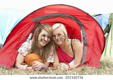 Young friends on camping trip - stock photo