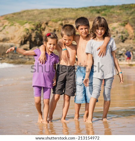 Young friends portrait at the beach. - stock photo