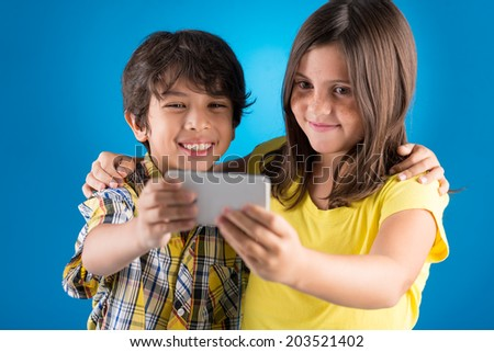 Young friends taking a self portrait - stock photo