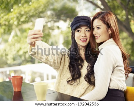 young friends taking selfie in coffee shop. - stock photo
