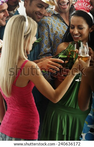 Young Friends Toasting at Party - stock photo