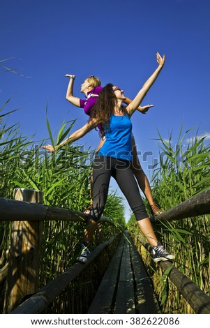 Young friends tourists are having fun - stock photo