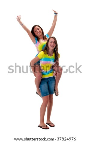 Young friends very playful and piggyback ride. - stock photo