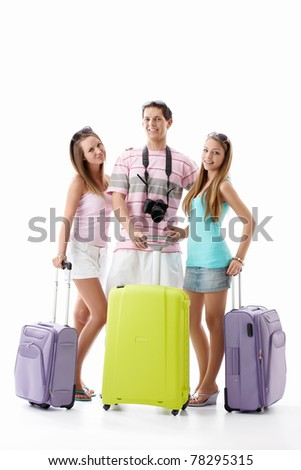 Young friends with suitcases on a white background - stock photo