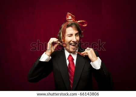 young funny guy with red ribbon on the head - stock photo