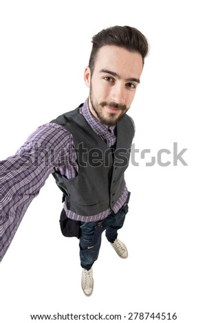 Young funny happy hipster taking self portrait or selfie. High view wide angle lens portrait isolated over white background.  - stock photo