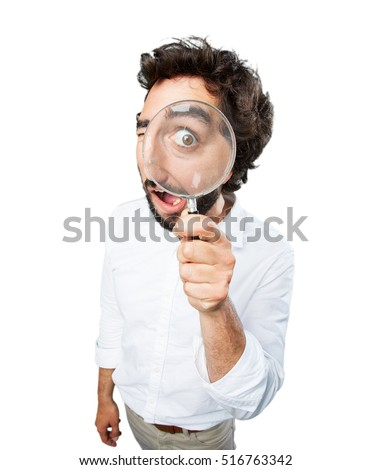 young funny man with magnifier. surprise expression