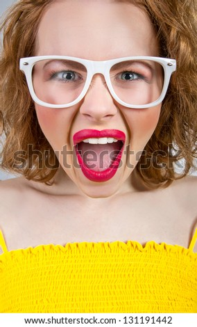 Young funny or angry woman screaming or yell, close up facial - stock photo