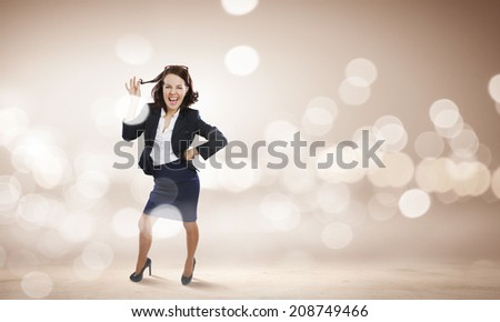 Young funny woman in suit against bokeh background