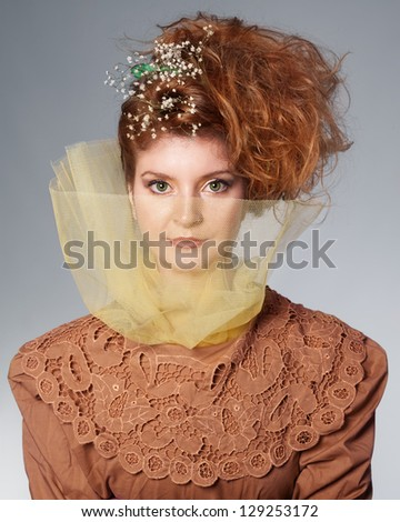 young ginger lady with beautiful green eyes looking at camera - stock photo
