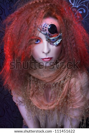 Young  ginger woman with artistic visage