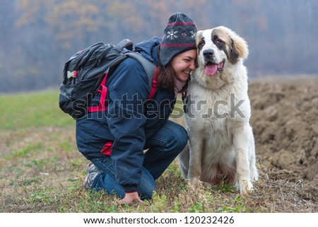 Young girl affection moment with her Bucovina shepherd dog - stock photo