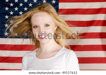 Young Girl and american flag studio portrait