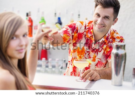 young girl and barmen with cocktail - stock photo