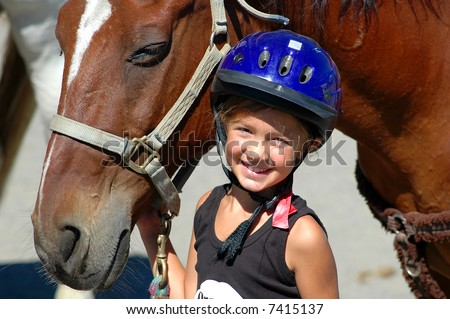 young girl and her horse - stock photo