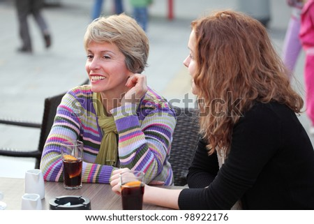 Young girl and mother in cafe, selective focus - stock photo