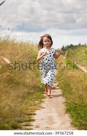 Young girl at rural road - stock photo